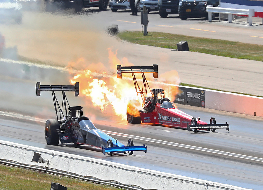 Sep 3, 2017; Clermont, IN, USA; NHRA top fuel driver Kyle Wurtzel (far) has an engine fire alongside Pat Dakin during qualifying for the US Nationals at Lucas Oil Raceway. Mandatory Credit: Mark J. Rebilas-USA TODAY Sports