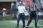 Wake Forest Demon Deacons head coach Dave Clawson has a discussion with Head Linesman Tracy Lynch during first half action against the Clemson Tigers at BB&T Field on October 6, 2018 in Winston-Salem, North Carolina. The Tigers defeated the Demon Deacons 63-3. (Brian Westerholt/Sports On Film)