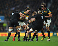 Lood de Jager of South Africa is tackled by Jerome Kaino of New Zealand during the Semi Final of the Rugby World Cup 2015 between South Africa and New Zealand - 24/10/2015 - Twickenham Stadium, London<br /> Mandatory Credit: Rob Munro/Stewart Communications