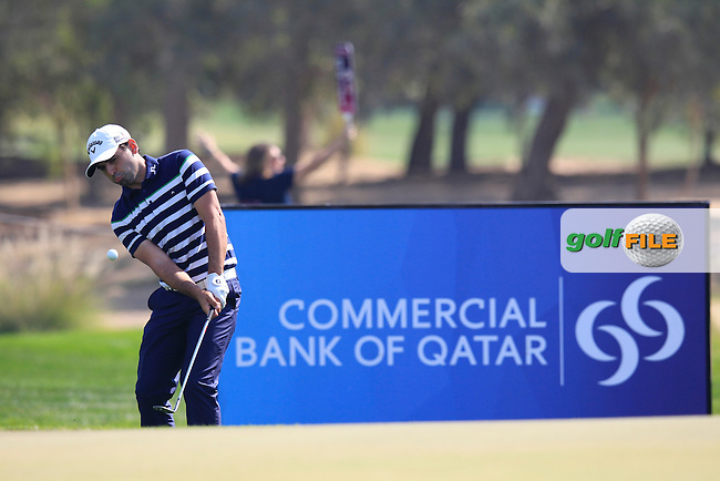 Fabrizio Zanotti (PAR) chips onto the 5th green during Friday's Round 3 of the Commercial Bank Qatar Masters 2014 held at Doha Golf Club, Doha, Qatar. 24th January 2014.<br /> Picture: Eoin Clarke www.golffile.ie