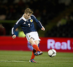 Stuart Armstrong strokes in the opening goal for Scotland