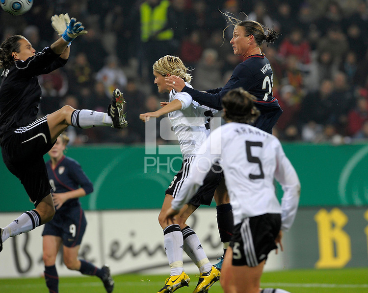 Abbt Wambach (20) and Saskia Bartusiak (3) go up for the ball. US Women's National Team defeated Germany 1-0 at Impuls Arena in Augsburg, Germany on October 27, 2009.