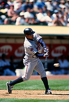 OAKLAND, CA - Manny Ramirez of the Cleveland Indians bats during a game against the Oakland Athletics at the Oakland Coliseum in Oakland, California on April 29, 1999. (Photo by Brad Mangin)