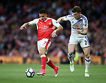 Arsenal's Alexis Sanchez tussles with Sunderland's Billy Sharp during the Premier League match at the Emirates Stadium, London. Picture date: May 16th, 2017. Pic credit should read: David Klein/Sportimage