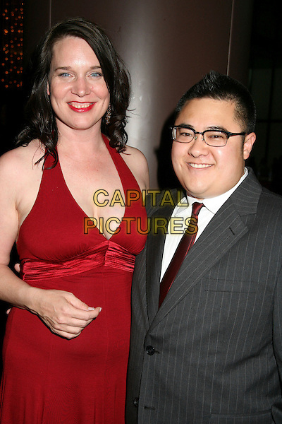 JANET HARVEY & CHARLIE CHU (PRODUCERS).The Filmmakers Alliance Honors Werner Herzog with 2006 Vision Award, Hollywood, California, USA..August 16th, 2006.Ref: ADM/BP.half length red halterneck dress cleavage grey gray glasses.www.capitalpictures.com.sales@capitalpictures.com.©Byron Purvis/AdMedia/Capital Pictures.