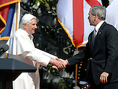 Washington, DC - April 15, 2008 -- Pope Benedict XVI, left, shakes hands with United States President George W. Bush, right, concluding the welcoming ceremony in the Pontiff's honor at the White House in Washington, D.C. on Wednesday, April 16, 2008.  .Credit: Ron Sachs / CNP.(RESTRICTION: NO New York or New Jersey Newspapers or newspapers within a 75 mile radius of New York City)
