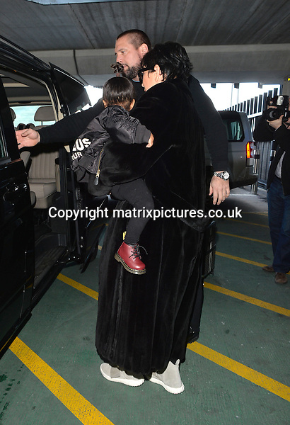 NON EXCLUSIVE PICTURE: PALACE LEE / MATRIXPICTURES.CO.UK<br /> PLEASE CREDIT ALL USES<br /> <br /> WORLD RIGHTS<br /> <br /> American television and media personality, Kris Jenner is pictured with her granddaughter North West at London Heathrow Airport.<br /> <br /> Baby North, whose parents are rapper Kanye West and media personality Kim Kardashian, looks adorable wearing one of her father's Yeezus jackets. <br /> <br /> MARCH 2nd 2015<br /> <br /> REF: LTN 15683