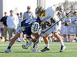 Tustin, CA 04/23/16 - Crew Taylor {La Costa Canyon #25) and Jared Copeland (Foothill #24) in action during the non-conference CIF varsity lacrosse game between La Costa Canyon and Foothill at Tustin Union High School.  Foothill defeated La Costa Canyon 10-9 in sudden death overtime.