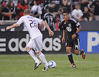 D.C. United midfielder Andy Najar (14) goes against Vancouver Whitecaps FC defender Jordan Harvey (26). D.C. United defeated The Vancouver Whitecaps FC 4-0 at RFK Stadium, Saturday August 13 , 2011.