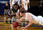 BROOKINGS, SD - DECEMBER 12: Ian Theisen #45 from South Dakota State dives to get control of the ball before Tray Buchanan #30 from North Dakota can secure it during their game Tuesday night at Frost Arena in Brookings, SD. (Photo by Dave Eggen/Inertia)