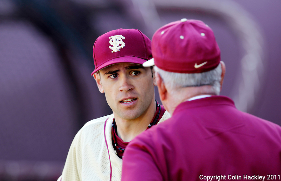 TALLAHASSEE, FL 2/12/10-FSUBASE 021211 CH-Florida State pitcher Sean Gilmartin, left, talks with Head Coach Mike Martin during the Fan Day scrimmage Saturday at the Dick Howser Stadium in Tallahassee...COLIN HACKLEY PHOTO