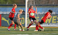 Philadelphia's Lori Lindsey (6) shoots towards goal, surrounded by Atlanta defenders, Laruren Sesselman (14), Stacy Bishop (4), and Johanna Rasmussen (13).  Atlanta and Philadelphia played to a 0-0 draw in the season opener for both teams at John A Farrell Stadium in West Chester, PA.