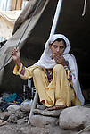 Rubina, a 30-year old a survivor of the October 2005 quake that almost completely destroyed her city of Balakot, spent months living in the rubble, sheltered by a motley collection of scrap materials and emergency tents and tarps. The quake measured 7.6 on the Richter scale and killed more than 74,000 people in northern Pakistan.