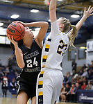 SIOUX FALLS, SD: MARCH 12:  Sydney Skaggs #24 of Central Missouri readies a shot over Augustana defender Paige Peterson #23 during the 2018 NCAA Division II Women's Basketball Central Region Championship Monday at the Elmen Center in Sioux Falls, S.D. (Photo by DIck Carlson/Inertia)