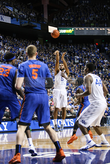 Kentucky guard Andrew Harrison shoots a three-point shot during the second half of the Kentucky vs. Florida game at Rupp Arena in Lexington, Ky.,on Saturday, March 7, 2015. UK defeated Florida 67-50, completing a perfect regular season. Photo by Adam Pennavaria | Staff