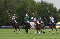 Gonzalo Pieres (King Power Foxes) heads the chase for the ball during the Cartier Queens Cup Final match between King Power Foxes and Dubai Polo Team at the Guards Polo Club, Smith's Lawn, Windsor, England on 14 June 2015. Photo by Andy Rowland.