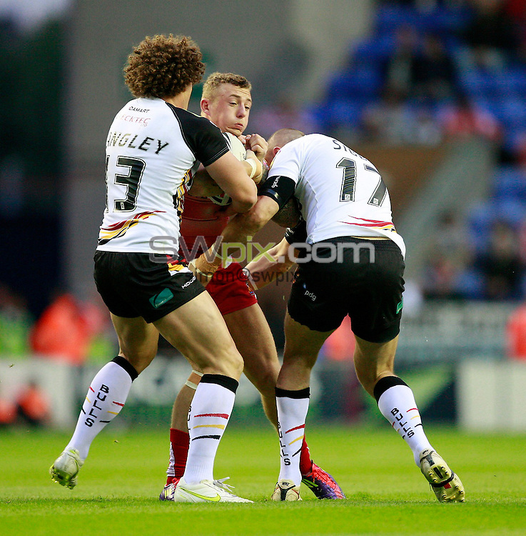 PICTURE BY CHRIS MANGNALL /SWPIX.COM...Rugby League - Super League  - Wigan Warriors v Bradford bulls - DW Stadium, Wigan, England  - 19/08/11... Wigan's Josh Charnley  tackles  Bradford's Jamie Langley and Ian Sibbit