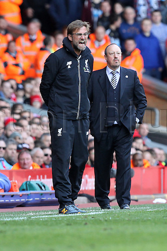 23.04.2016. Anfield Stadium, Liverpool, England. Barclays Premier League. Liverpool versus Newcastle United. Jurgen Klopp, Liverpool manager rages at his team from the technical area as Rafa Benitez, manager of Newcastle United looks on.