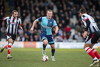 Garry Thompson of Wycombe Wanderers under pressure from Jamey Osborne of Grimsby Town during the Sky Bet League 2 match between Grimsby Town and Wycombe Wanderers at Blundell Park, Cleethorpes, England on 4 March 2017. Photo by Andy Rowland / PRiME Media Images.