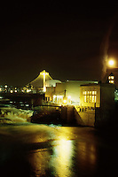 The old Spokane Paper mill with the Spokane River flowing by.  The background shows the River front park icon.