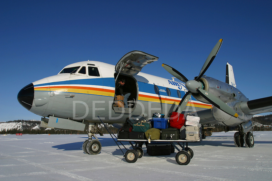 An Air North plane at the local airport in the home territory of the Vuntut Gwitchin First Nation in Old Crow, Yukon Territory, Canada. Old Crow is the only Yukon village with no road access. It is an isolated fly-in community.