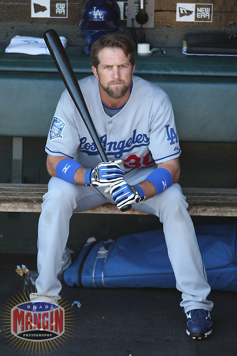 SAN FRANCISCO - SEPTEMBER 28:  Casey Blake of the Los Angeles Dodgers gets ready in the dugout before the game against the Los Angeles Dodgers at AT&T Park in San Francisco, California on September 28, 2008.  The Giants defeated the Dodgers 3-1.  Photo by Brad Mangin