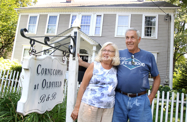SOUTHBURY CT. 27 July 2017-073117SV03-Ed Edelson and his wife Christine Edelson stand outside Cornucopia at Oldfield Bed and Breakfast in Southbury Monday.<br /> Steven Valenti Republican-American