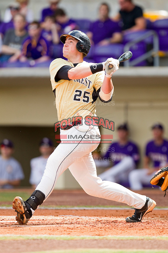 Matt Conway #25 of the Wake Forest Demon Deacons follows through on his swing against the LSU Tigers at Alex Box Stadium on February 20, 2011 in Baton Rouge, Louisiana.  The Tigers defeated the Demon Deacons 9-1.  Photo by Brian Westerholt / Four Seam Images