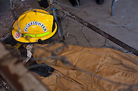 A donated helmet sits on a cot at the Port-au-Prince, Haiti fire station. The building has been deemed uninhabitable after the January 12 earthquake and marked for demolition, though no one can say when that may be. There are no plans yet for relocation. A few dozen under-equipped firefighters are tasked with providing fire service to a damaged city of over two million people.