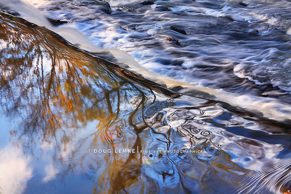 Autumn Leaves And Blue Sky Reflected In River Water Plunging Over A Waterfall, Sharon Woods, Southwestern Ohio, USA