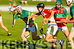 Kilmoyleys Daniel Collins keeps an eye on Adam O'Sullivan the Crotta O'Neills keeper in the Senior Hurling Championship Qtr final in Austin Stack Park on Saturday.