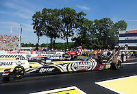 Jun. 3, 2012; Englishtown, NJ, USA: NHRA top fuel dragster driver Shawn Langdon (near lane) races alongside Dom Lagana during the Supernationals at Raceway Park. Mandatory Credit: Mark J. Rebilas-