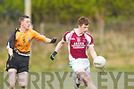 Brendan Foley of Cromane breaks away from Asdee's Con Carmody last Saturday night in Asdee.
