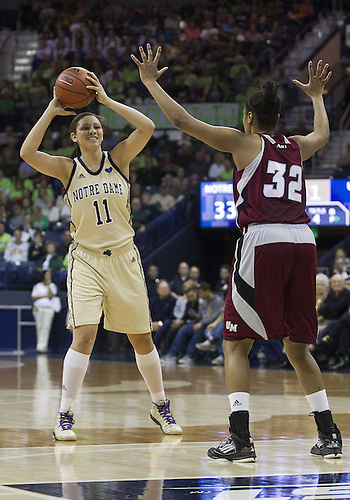 November 18, 2012:  Notre Dame forward Natalie Achonwa (11) looks to pass the ball as Massachusetts center Jasmine Watson (32) defends during NCAA Women's Basketball game action between the Notre Dame Fighting Irish and the Massachusetts Minutewomen at Purcell Pavilion at the Joyce Center in South Bend, Indiana.  Notre Dame defeated Massachusetts 94-50.