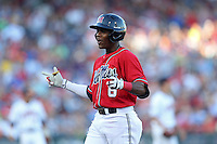 Errol Robinson #6 of the Ole Miss Rebels celebrates during Game 4 of the 2014 Men's College World Series between the Virginia Cavaliers and Ole Miss Rebels at TD Ameritrade Park on June 15, 2014 in Omaha, Nebraska. (Brace Hemmelgarn/Four Seam Images)