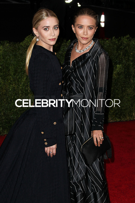 """NEW YORK CITY, NY, USA - MAY 05: Ashley Olsen, Mary-Kate Olsen at the """"Charles James: Beyond Fashion"""" Costume Institute Gala held at the Metropolitan Museum of Art on May 5, 2014 in New York City, New York, United States. (Photo by Xavier Collin/Celebrity Monitor)"""