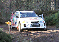 Rory Young - Alan Cathers in a Mitsubishi Evolution 5 competing at Junction 6 on the Munro Scotch Beef Millbuie Special Stage 1 on the 2014 Arnold Clark/Thistle Hotel Snowman Rally, supported by Highland Office Equipment, part of Capital Document Solutions which was organised by Highland Car Club and based in Inverness on 22.2.14; Round 1 of the 2014 RAC MSA Scottish Rally Championship sponsored by ARR Craib Transport Limited.