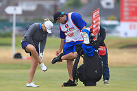 Sarah Kemp (AUS) and her caddy cleaning their shoes on the 17th fairway during Round 2 of the Ricoh Women's British Open at Royal Lytham &amp; St. Annes on Friday 3rd August 2018.<br /> Picture:  Thos Caffrey / Golffile<br /> <br /> All photo usage must carry mandatory copyright credit (&copy; Golffile | Thos Caffrey)