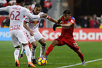 Harrison, NJ - Thursday March 01, 2018: Tyler Adams, Michael Chirinos. The New York Red Bulls defeated C.D. Olimpia 2-0 (3-1 on aggregate) during a 2018 CONCACAF Champions League Round of 16 match at Red Bull Arena.