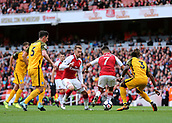 1st October 2017, Emirates Stadium, London, England; EPL Premier League Football, Arsenal versus Brighton; Alexis Sanchez of Arsenal back heels a pass to Alex Iwobi of Arsenal who scores his sides second, 2-0 Arsenal