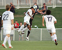 Barry Rice #15 of D.C. United clashes with Sheanon Williams #20 of the Harrisburg City Islanders during a US Open Cup match at the Maryland Soccerplex on July 21 2010, in Boyds, Maryland. United won 2-0.