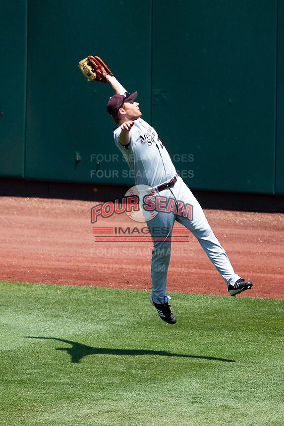 Derek Mattea (15) of the Missouri State Bears makes a leaping grab during a game against the Wichita State Shockers in the 2012 Missouri Valley Conference Championship Tournament at Hammons Field on May 23, 2012 in Springfield, Missouri. (David Welker/Four Seam Images)