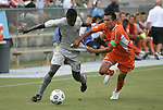 03 July 2012: Carolina's Kupono Low (right) pulls the jersey of Atlanta's Borfor Carr (LBR) (19). The Carolina RailHawks defeated the Atlanta Silverbacks 2-1 at WakeMed Soccer Stadium in Cary, NC in a 2012 North American Soccer League (NASL) regular season game.