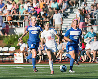 In a National Women's Soccer League Elite (NWSL) match, the Boston Breakers defeated the FC Kansas City, 1-0, at Dilboy Stadium on August 10, 2013.  FC Kansas City midfielder/forward Erika Tymrak (15) dribbles the ball as Boston Breakers midfielder Joanna Lohman (11) and Boston Breakers defender Carmelina Moscato (19) give chase.