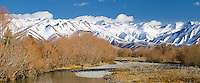 Snowy mountains reflected in the Twizel river. Sunny winter's day. South Island