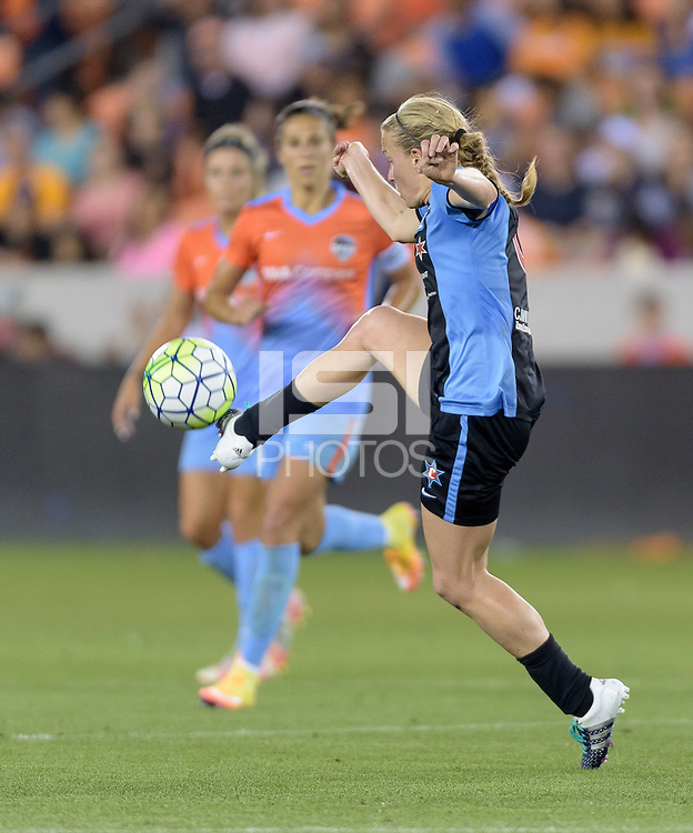 Alyssa Mautz (4) of the Chicago Red Stars gains control of a loose ball in the second half against the Houston Dash on Saturday, April 16, 2016 at BBVA Compass Stadium in Houston Texas.