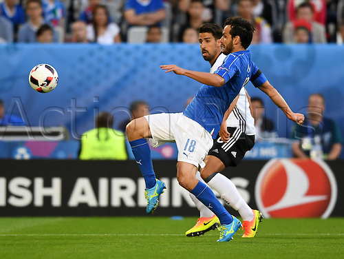 02.07.2016. Bordeaux, France.  Germany's Sami Khedira (back) and Italy's Marco Parolo challenge for the ball during the UEFA EURO 2016 quarter final soccer match between Germany and Italy at the Stade de Bordeaux in Bordeaux, France, 02 July 2016.