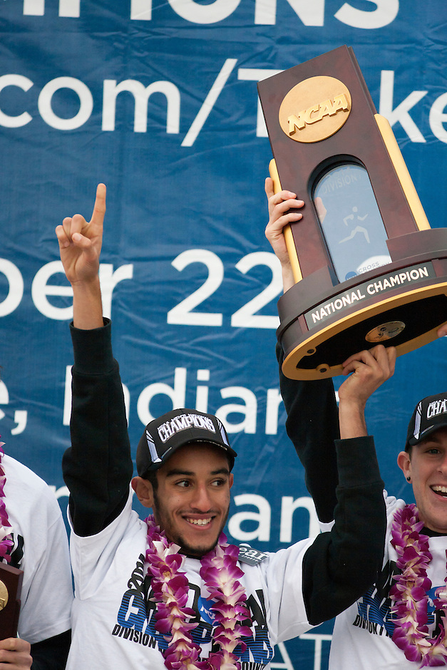 Colorado's Ammar Moussa (87) holds the trophy after the team won the NCAA Division I Men's Cross Country National Title in Terre Haute, Ind. on Saturday, Nov. 22, 2014. Moussa finished fifth and was the team's highest-finishing runner. (James Brosher, Special to the Denver Post)