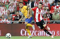 Athletic de Bilbao's Aritz Aduriz (r) and FC Barcelona's Daniel Alves during Supercup of Spain 1st match.August 14,2015. (ALTERPHOTOS/Acero)