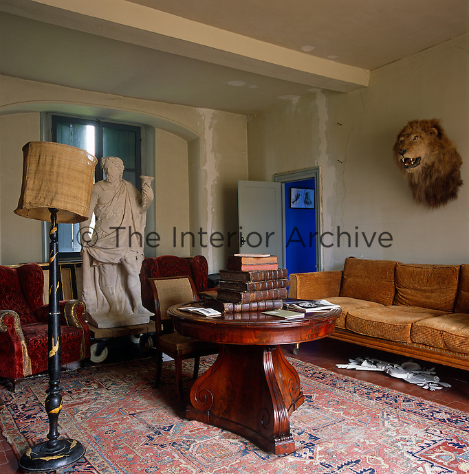 Restoration is in progress while this living room is used for housing a random collection of furniture and objects
